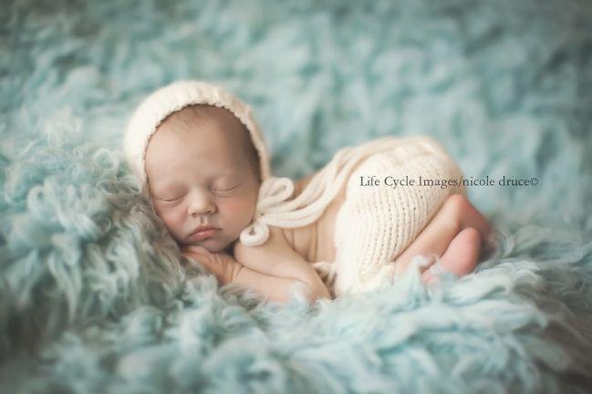 Newborn on flokati newborn props outdoor newborn photography on location photographer life