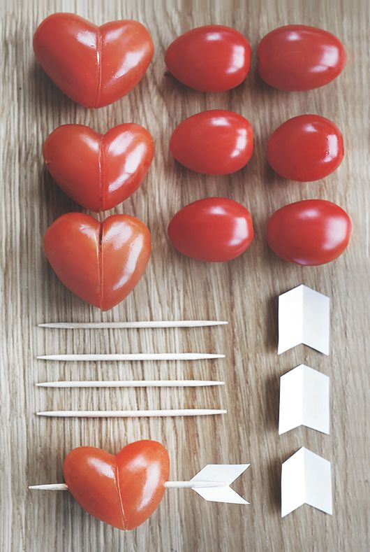 Heart-shaped tomatoes with a toothpick arrow. #PANDORAloves these romantic and healthy snacks.