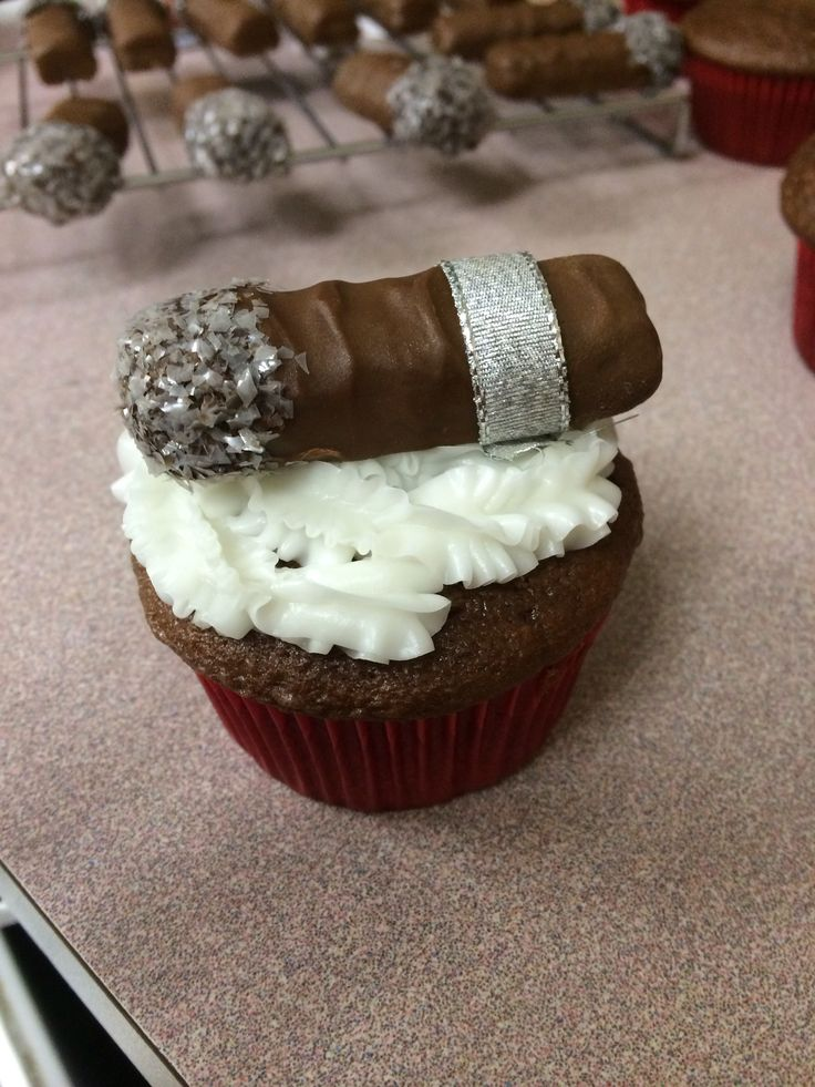 Cigar cupcakes   Twix dipped in melted chocolate with sprinkles at the end to look like ash. With ribbon tied around as the label