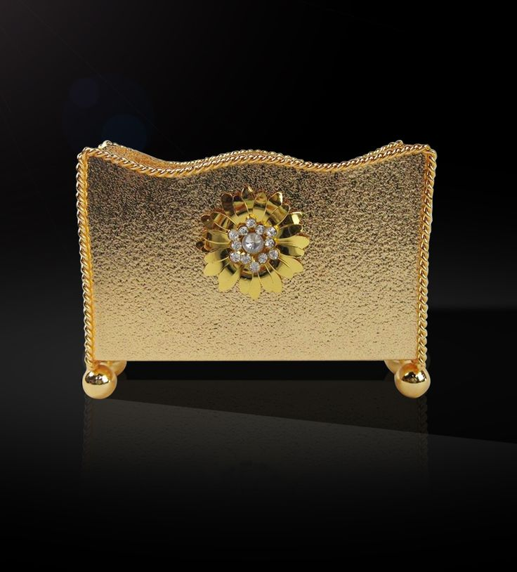 Napkin Holder with Flower  This elegantly designed napkin holder with contemporary design and glossy finish is a marvelous piece to add to your collection from the gold collection.  http://www.thedivineluxury.com/product/Napkin-Holder-with-Flower.html