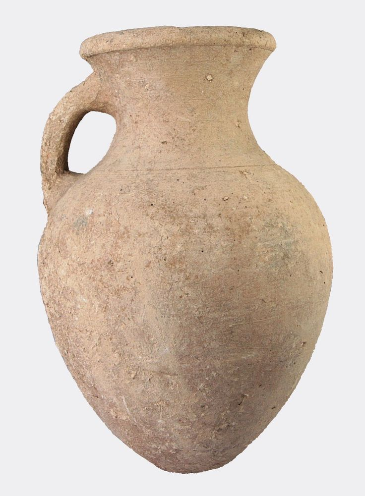 A large buff pottery jug with a single handle and ovoid body, the shoulder is decorated with a group of incised bands.  Roman, probably Palestine region, circa 3rd Century AD