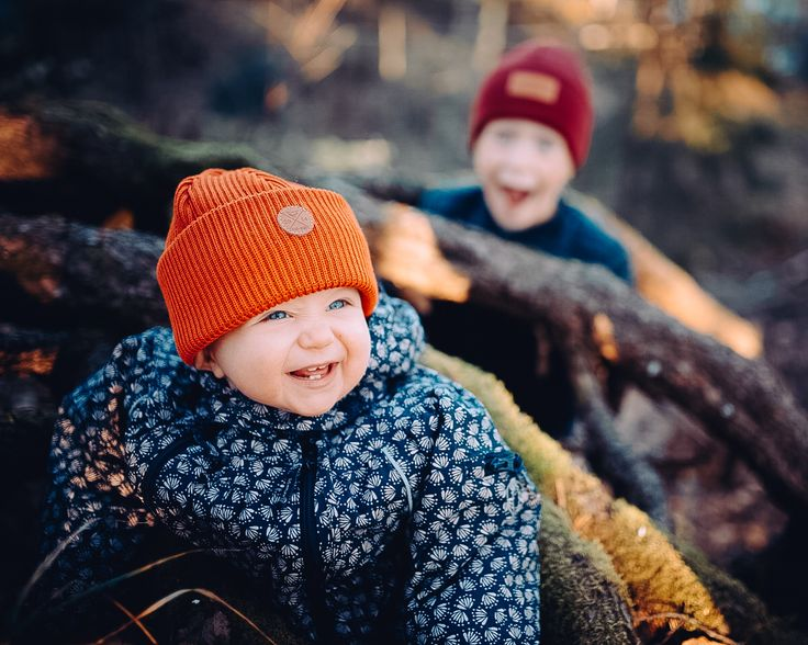 A Safe Adventure. Kids with their Merino Wool Beanies in Copper and Burgundy.