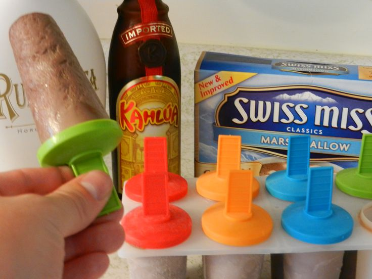 Adult Frozen Hot Chocolate:  My own little experiment that worked out quite well... 1 1/2  cups of skim milk heated up a little.  4 packets of hot chocolate, mix it in.  2 shots of kahlua, 2 shots of RumChatta.  Mix it all up and pour it into your child's handy dandy popsicle holder and freeze overnight.  Don't give it to your child.  In fact, make sure you set aside some not alcoholic ones for your child.  Then...enjoy!