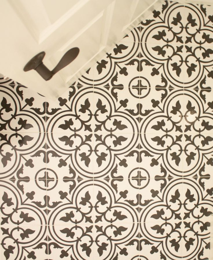 Goose Creek Bathroom Project: We used Merola Arte White Porcelain tile from Home Depot to mimic the look of encaustic cement tile, but at a much more affordable cost.