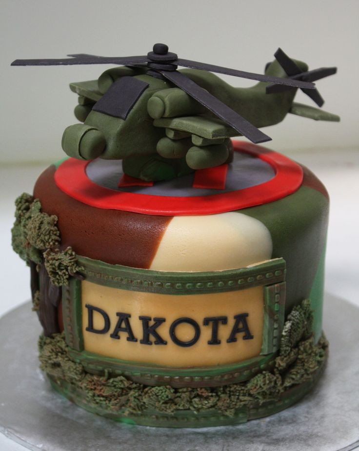 Apache helicopter cake with camo fondant and helipad.