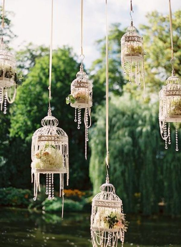 Hanging Birdcage Wedding Decor / http://www.deerpearlflowers.com/hanging-wedding-decor-ideas/2/