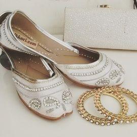 Wedding Shoes - White Juttis   WedMeGood Classic White Juttis with Swarovski Studded. Perfect for Wedding Functions #wedmegood #juttis #shoes