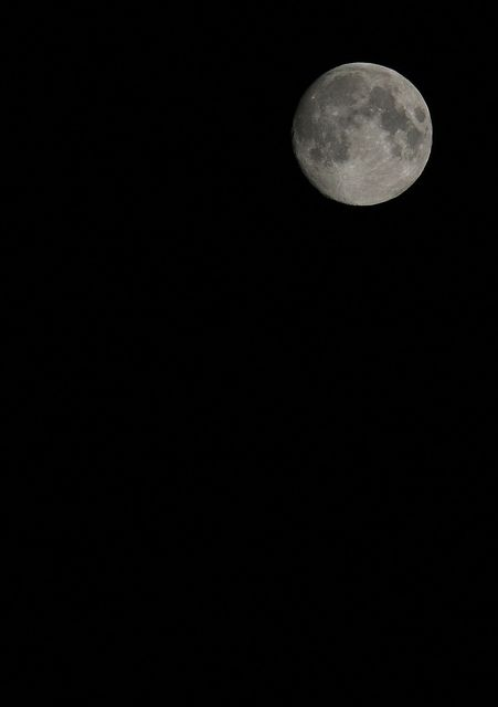 This is my best shot at the moon. I have enhanced it slightly and cropped it in PhotoScape. You can recognise the patterns, but it's still so far away. ;)  1/125 sec, f/11, 200 mm, ISO 100, tripod