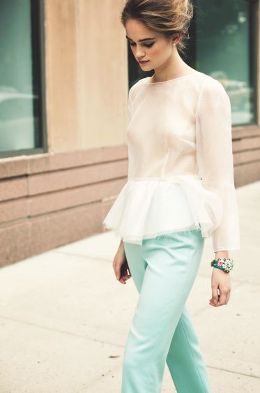Sheer peplum paired with mint colored pants.
