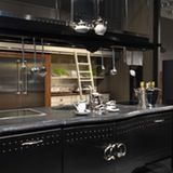 Who: Marchi Group What We Noticed: Most of the kitchen design at EuroCucina fell into one of two buckets: Sleek and minimalist, or over-the-top rococo luxury. So this showroom from Italian Marchi Group felt very different. These kitchens are like fantasy ideals of American and British kitchens, with casual details like chalkboard walls, faux-industrial pendants, and zinc tabletops. This showroom was absolutely packed with crowds every time I walked by!