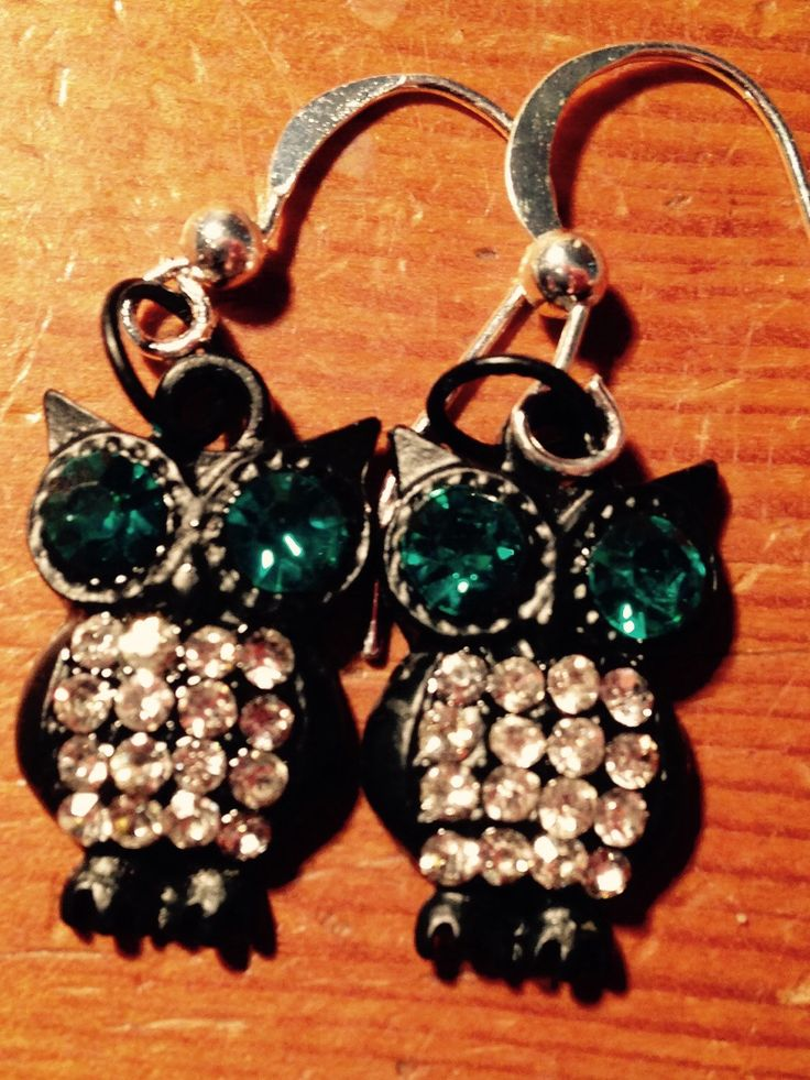 A personal favorite from my Etsy shop https://www.etsy.com/listing/232493253/owl-earring-green-eyes