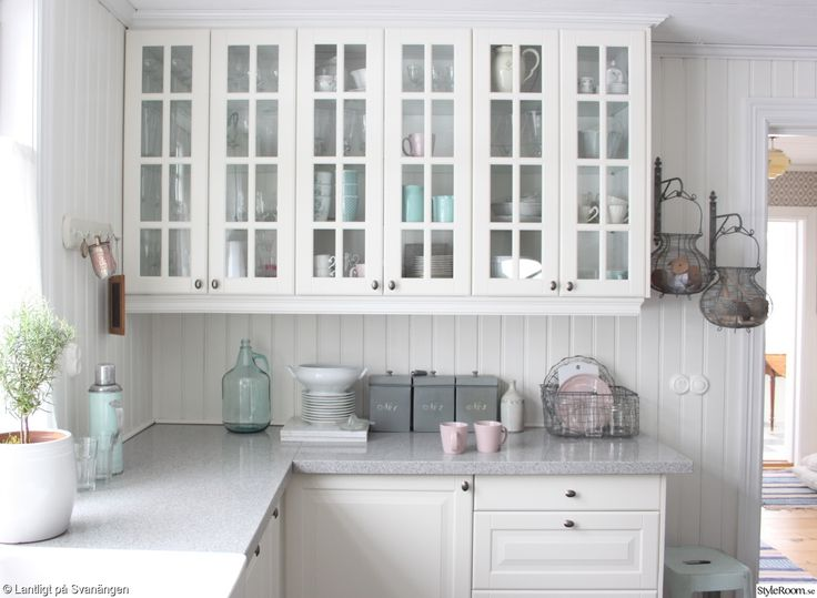 White kitchens are in.. farm sinks, beadboard, marble countertops!!