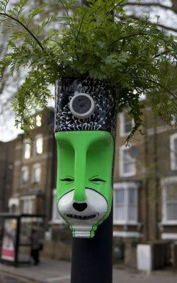 SO fabulous for community projects!  Love how the jug is decorated simply and attached to a pole on the street.  I remember plant displays on street lights as a kid and it really brings a homey feeling to a community instead of always looking at sterile industry.