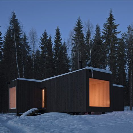 Modern wood cabin style house using box like construction.