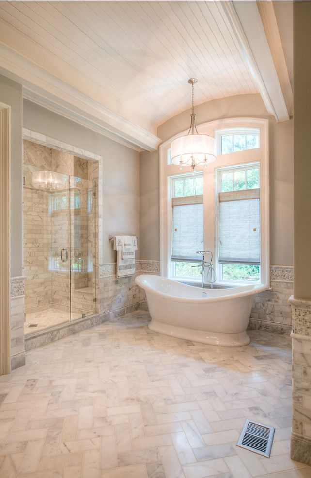 Beautiful Architecture and Interiors The master bathroom is serene and timeless. I love the honed marble flooring. By the way, honed marble is safer than polished marble, since it's less slippery. Either way, I always recommend bath rugs by the shower and bath.