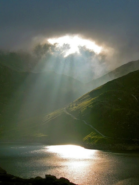 Great photo and captures the Welsh weather in one image - rain, cloud and sun all at the same time
