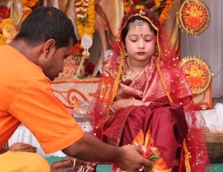 """One of those forms is the """"Kumari"""", the Virgin form.A girl aged between one to sixteen, symbolizing the Kumari form of  Devi is worshipped in front of the idol of Goddess Durga on Ashtami or sometimes  Nabami."""