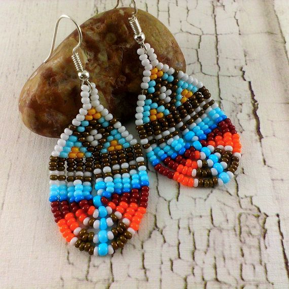 Delicate earrings made of seed beads in red, orange, blue, brown and white.  Length: 2 1/2 inches ( 6.2 cm )  Width: 1 1/8 inches ( 2.7 cm )  More beaded earrings here https://www.etsy.com/ru/shop/Galiga?ref=hdr_shop_menu%C2%A7ion_id&section_id=14580559   Please note that due to lighting effects, monitors brightness, contrast and other settings, there might be some slight differences in the color tone/shade of the web sites photo and the a...