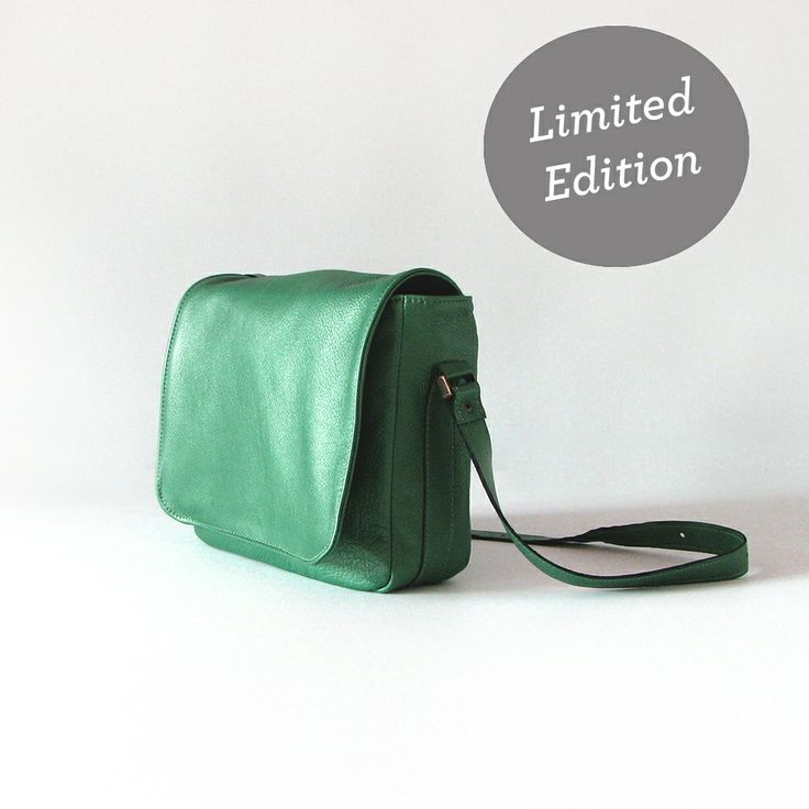 The Janet Saddles Sister handbag is handmade from quality emerald cowskin leather with a slight metallic finish.