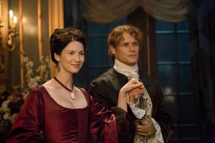 Caitriona Balfe as Claire Fraser and Sam Heughan as Jamie Fraser...