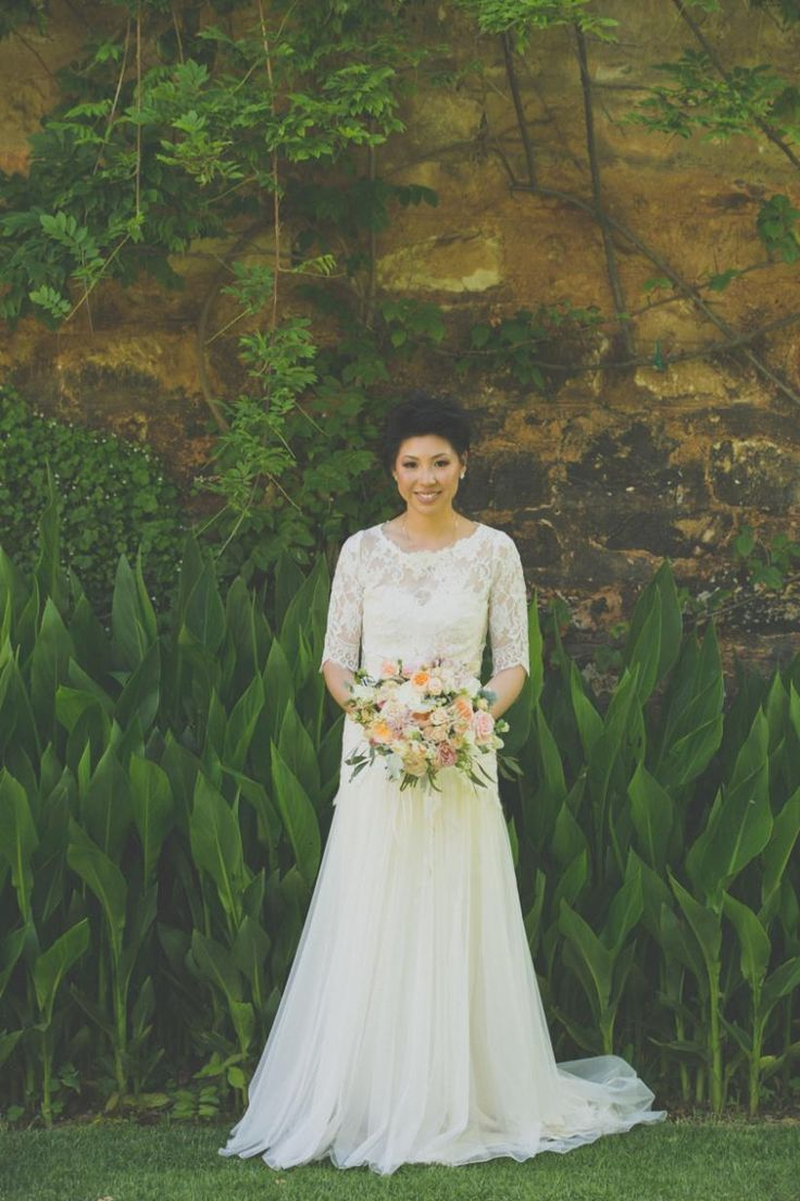 Caleche #realbride in the Alicia gown with matching lace jacket.