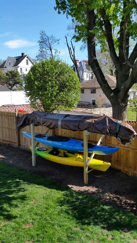 Our canoe kayak rack to existing fence. Always on the north side of your south fence when possible. Keep it simple. Use what you got to your advantage. Photo Mark Meberg. PEACE