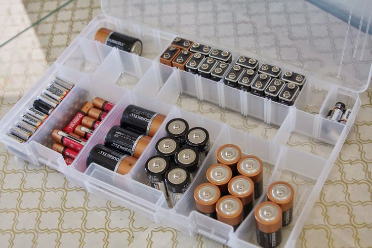 Batteries are a junk drawer nuisance! Organize them by type in a dollar store plastic container! #POCHacks