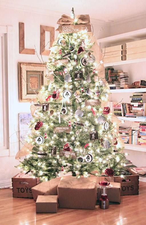 Christmas Tree Decoration Ideas -  Bright white lights and an eclectic mixture of ornaments, ranging from mini plaid accessories to wooden ski trail  signs.