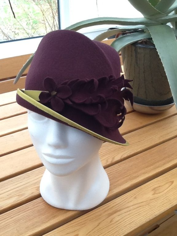 My take on a 1920's style hat (Downton Abbeyesk). It started of life as a trilby but I put it sideways on the mannequin and ta da!  Think it looks much better. By Nicky Gale.