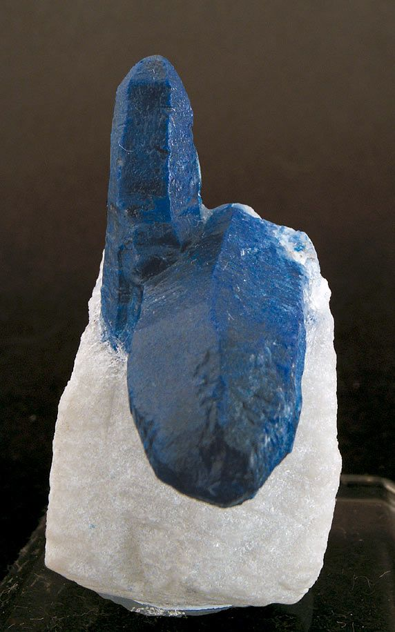 Afghanite  is a hydrous sodium, calcium, potassium, sulfate, chloride, carbonate alumino-silicate mineral. Afghanite is a feldspathoid of the cancrinite group & typically occurs w/ sodalite group minerals. It forms blue to colorless, typically massive crystals in the hexagonal crystal system. It has a Mohs hardness of 5.5 to 6