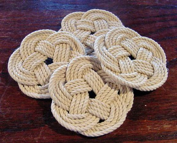 Turk's Head Coasters. Set of four coasters using the turk's head knot; made from a cotton/polyester twine; quadrupled three-lead; five-bight turk's heads that go right in the washing machine ... drip dry!