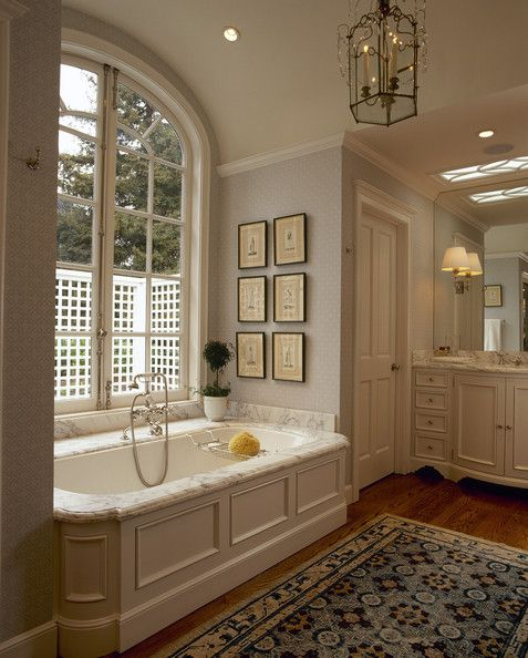 Tub Surround With Mouldings; Arched Window Above Tub.