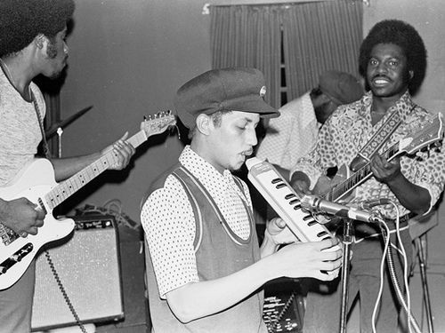 AUGUSTUS PABLO AT RANDY'S RECORDING STUDIO, 1975. PHOTO © TED BAFALOUKOS