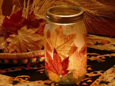 Modge Podge leaves on a jar to make a cute candle holder.