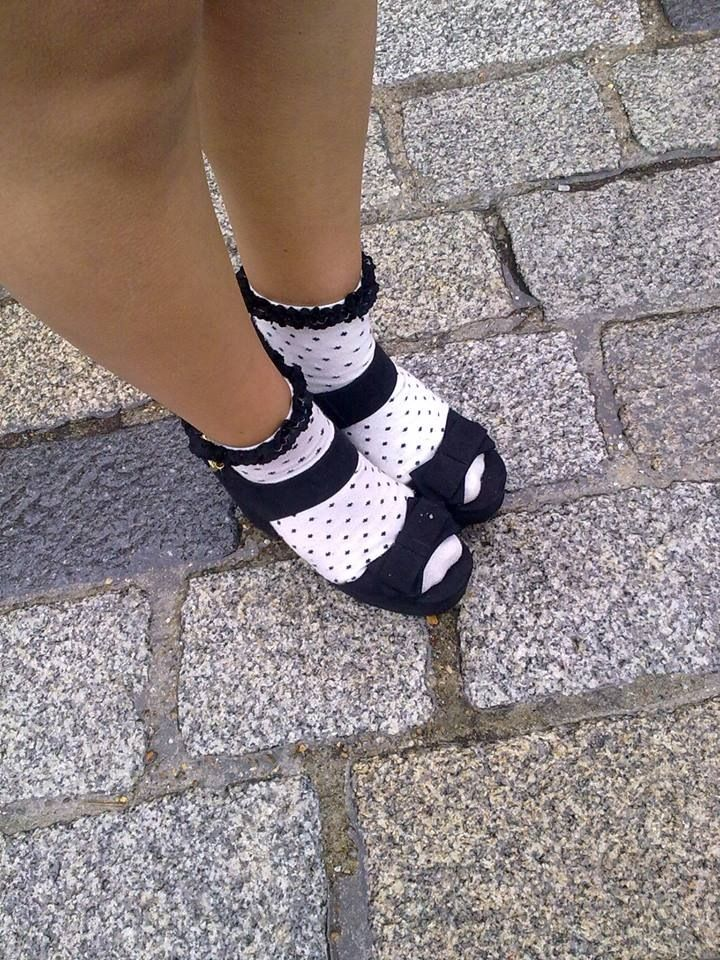 Sandals and socks are often a 'no no' in the eyes of most people therefore the girl photographed is showing a more directional approach to wearing the combination #polkadots #fashion #socks