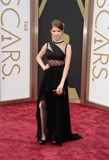 Our girl crush Anna Kendrick opts for black and berry shades. Also – will she be this year's Angelina with that protruding leg? #justsayin #Oscars