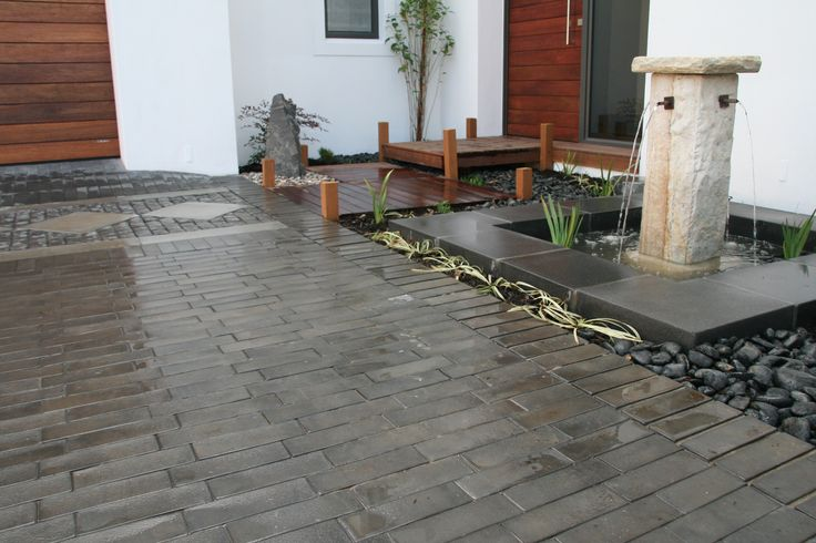 Beautiful Jura Pavers and Devon wall capping. Adding elegance to any landscaping areas.
