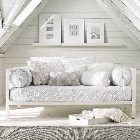 A chic, white daybed for your guest room.