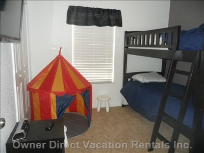 Kids friendly townhouse in a complex in Orlando. Only 8 miles from Disney, it's the perfect place to come back to and unwind from a long day at the parks.