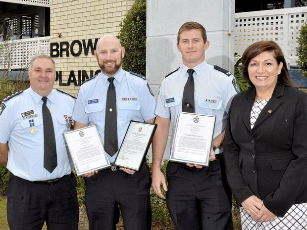 SERVICE: Inspector Mick Dowdy, who has done 35 years of service, and Senior Constable Daniel Kelly and Constable Michael McEwan, who were awarded for saving a man's life, with State MP Leeanne Enoch.