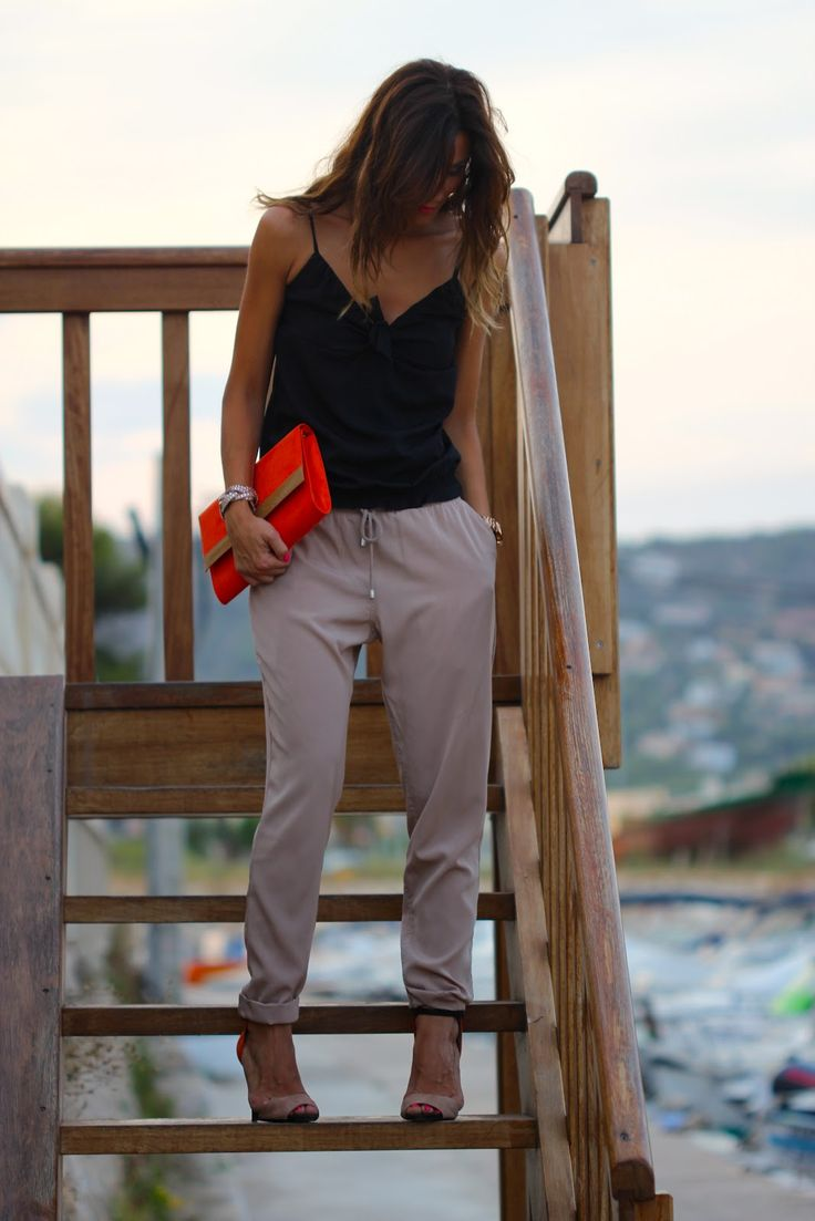 Slouchy pants rolled to ankle length... bright mandarin and nude look edgy chic with black and gold accents.