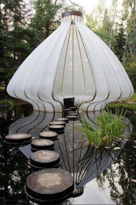Silk lantern in 'Le Jardin des Hespérides' designed by Andy Cao and Xavier Perrot. Silk lantern looms oversized but weightless in a reflecting pond. The lantern, fabricated according to traditional construction techniques and sewn by villagers in Vietnam. This photo was taken during Jardins de Métis edition 2006 - 2007 in Grand-Métis, Quebec, Canada.