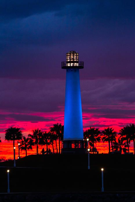 Lighthouse In The Firey Sky by Denise Dube