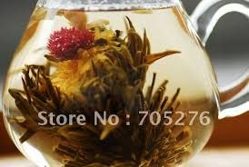 Image result for flowers that open in tea