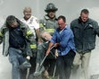 """This one gets me each time I see it.                      Rescue workers carry mortally injured New York City Fire Department chaplain Mychal Judge from the wreckage after he was killed by falling debris while administering last rites to another victim. A Roman Catholic priest, a recovering alcoholic, a gay man, and -- as an FDNY chaplain a spiritual adviser and trusted friend to countless firefighters through the years -- """"Father Mike"""" was the first recorded victim of the September 11…"""