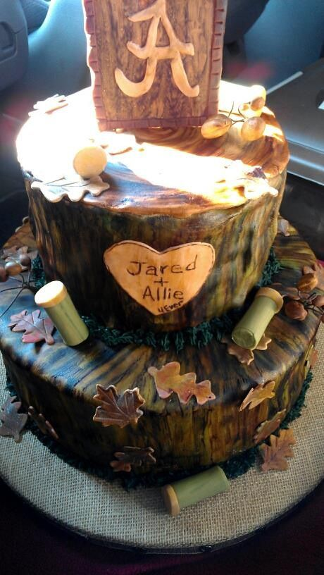 Hand painted fondant.  Everything edible!  Camo groom's cake!!!