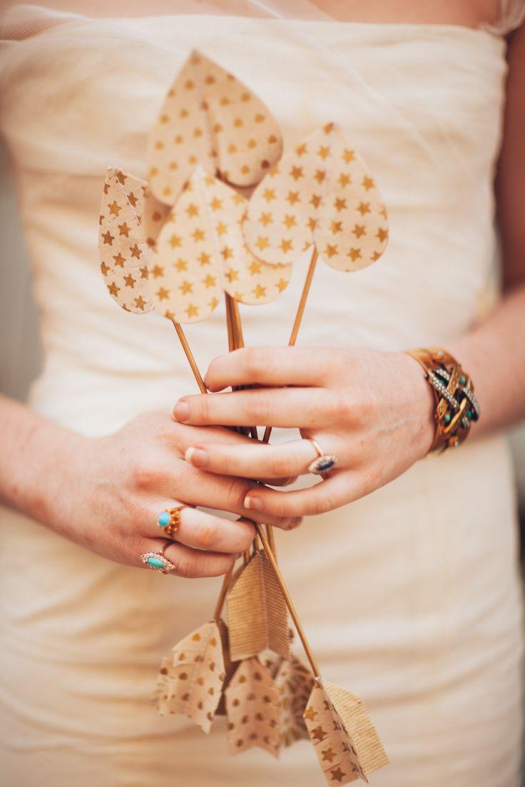 DIY gold heart arrows | Read More: http://www.stylemepretty.com/2014/08/18/diy-gold-heart-arrows-rustic-whimsical-wedding-inspiration/ | Photography: Studio Finch - www.studiofinch.com