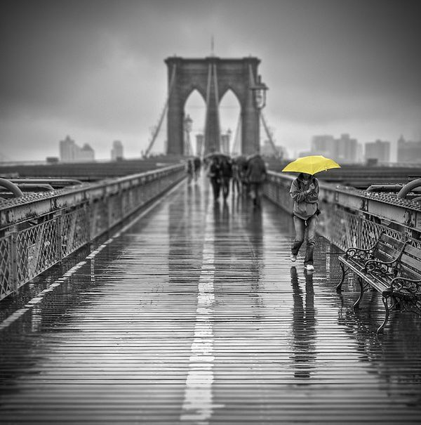 Selective color photography bridge w yellow umbrella
