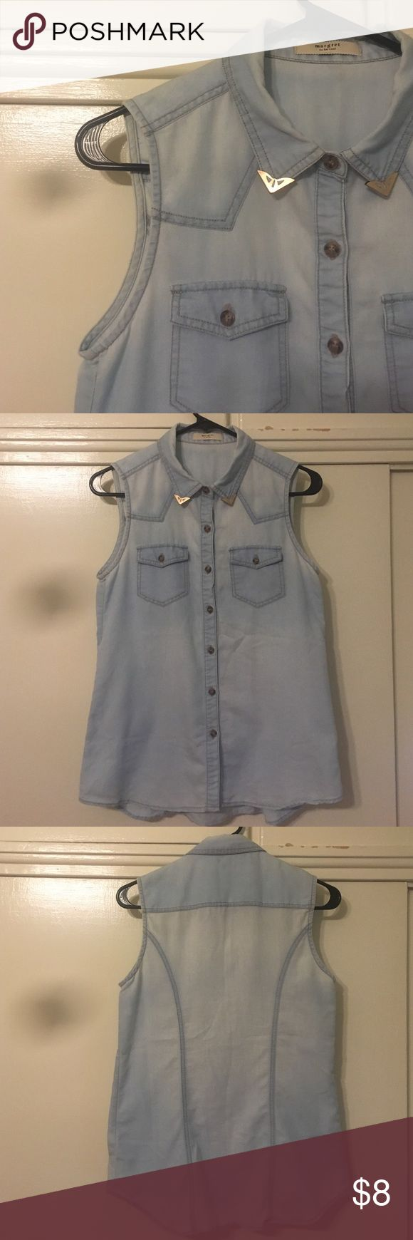 Sleeveless Denim Shirt Light blue, sleeveless, denim shirt with gold plated corners on tips of collar. Otherwise, fairly basic. Worn in but still looks pretty good, especially when layered! Tops