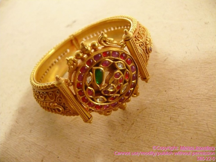 gold-bangles with polished ruby inspired from South India temple jewellery.Description by Pinner Mahua Roy Chowdhury